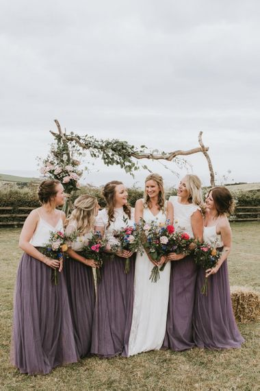Bridal party with wildflower bouquets at vegan wedding