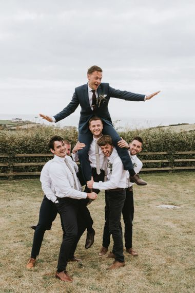 Groomsmen in matching outfits at vegan wedding