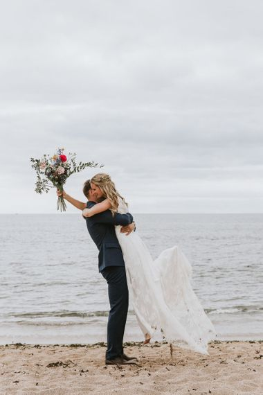 Coastal wedding in Devon with wildflower bouquet