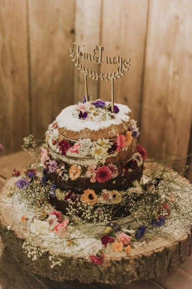 Homemade naked  wedding cake with flower decoration