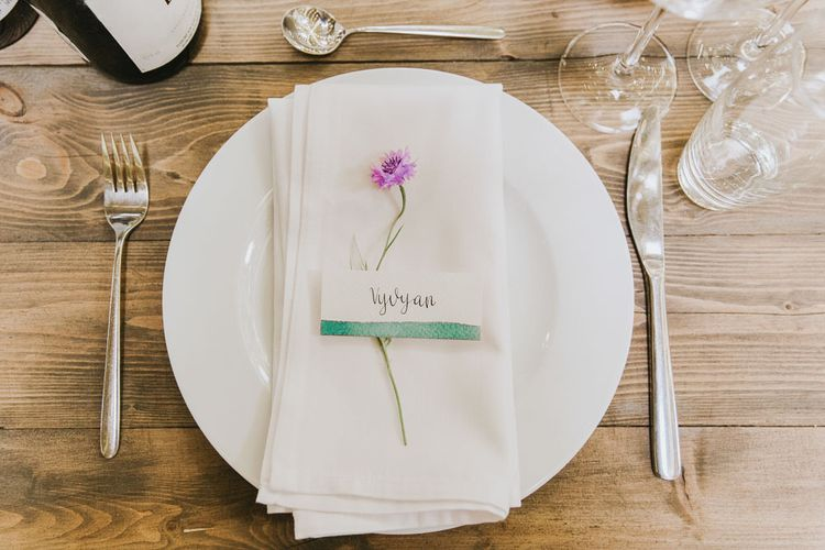 Wildflower place setting at vegan wedding