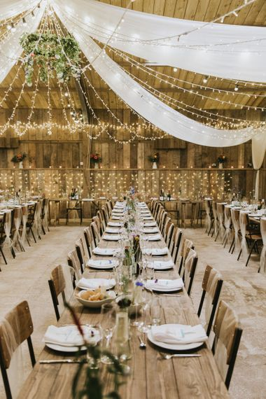 Fairy light canopy and drapes over vegan wedding breakfast