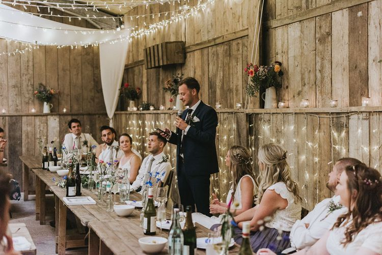 Wedding speeches with fairy light backdrop