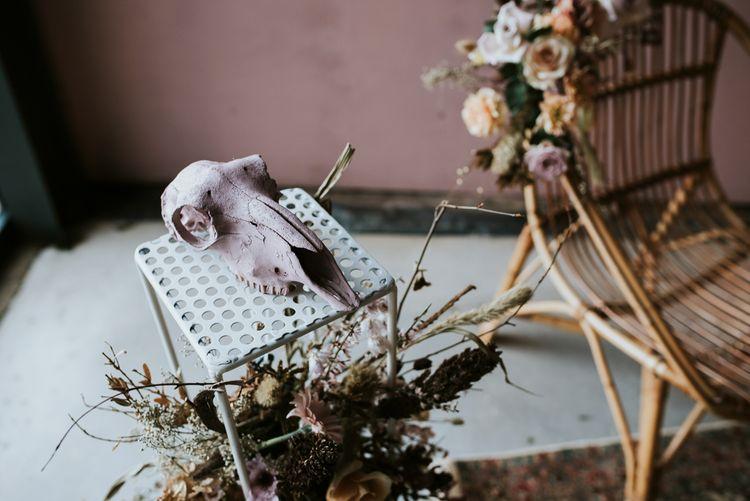 Skull Wedding Decor with Dried Flowers & Wicker Chair