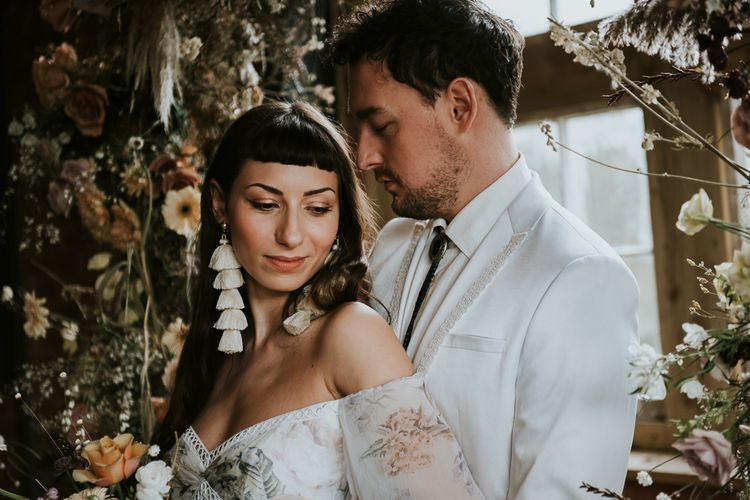 Bride in Tassel Earring and Off the Should Wedding Dress