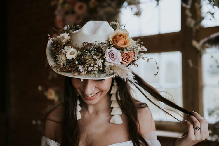 Boho Bride Wearing Cowboy Hat Decorated with Dried Flowers
