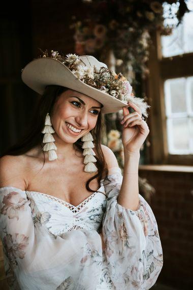 Bride Wearing Tassel Earrings and Cowboy Hat