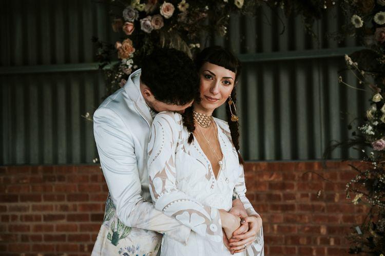 Bohemian Bride and Groom Embracing