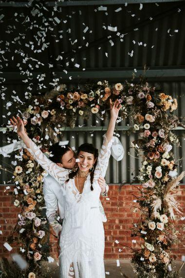Bride and Groom Celebrating with Confetti Cannon