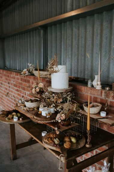 Dessert Table with an Array of Cakes Decorated with Dried Flowers