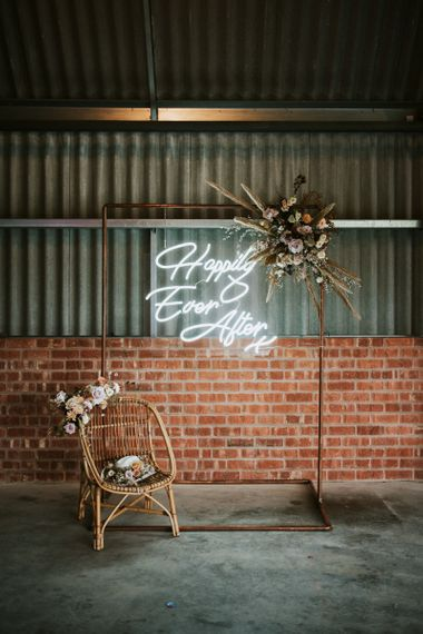 Happily Ever After Neon Sign on Copper Frame with Dried Flowers Wedding Decor