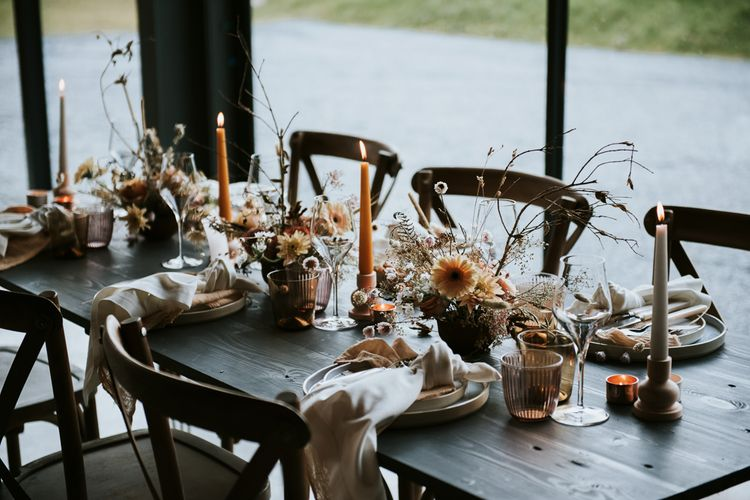Coloured Candles, Floral Centrepieces and Beautiful Place Settings