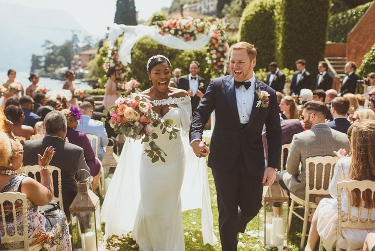 Bride and Groom walk up the aisle as husband and wife