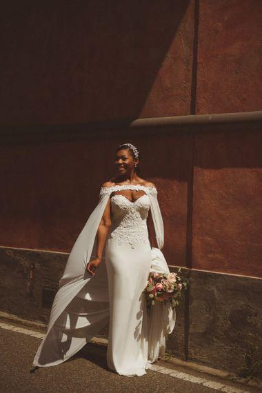 Bride in Justin Alexander bridal cape for Lake Como wedding