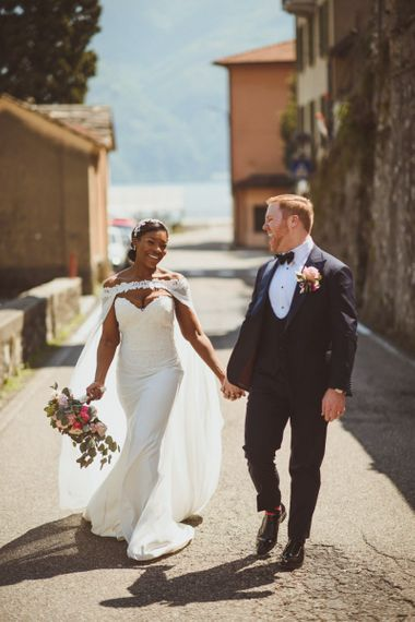 Stylish bride and groom in Tuxedo and bridal cape