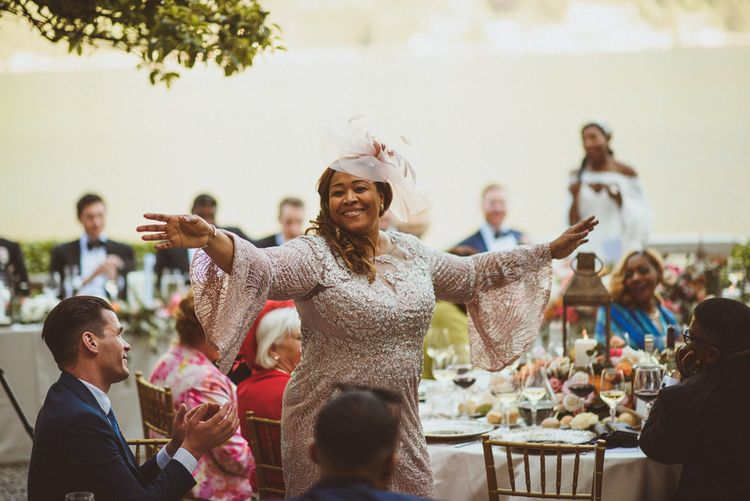 Beautiful Mother of the Bride in blush bell sleeve  dress