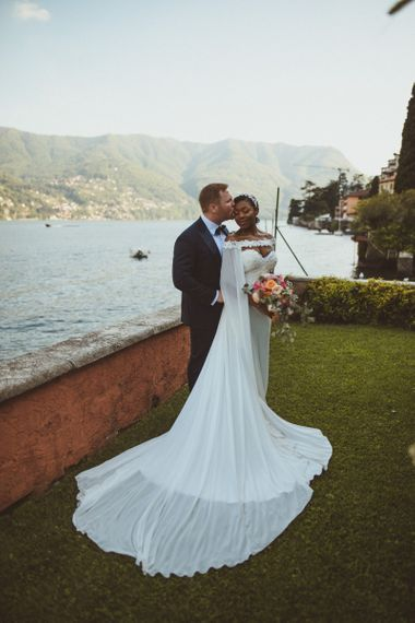 Bride and groom portrait with Lake Como backdrop
