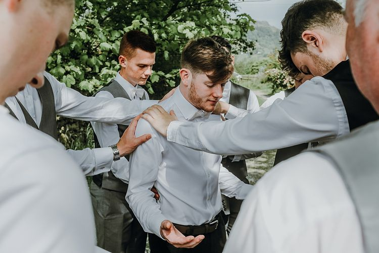Grooms Morning Preparations. Tipi Wedding at Home, Cumbria. Pale Dusky Pink, White and Mocha Flowers, Handwritten Details and Festoon Lights. Bride wears Essence of Australia Dress from Angelica Bridal. Groom wears Olive Next Suit and Tan Office Shoes.