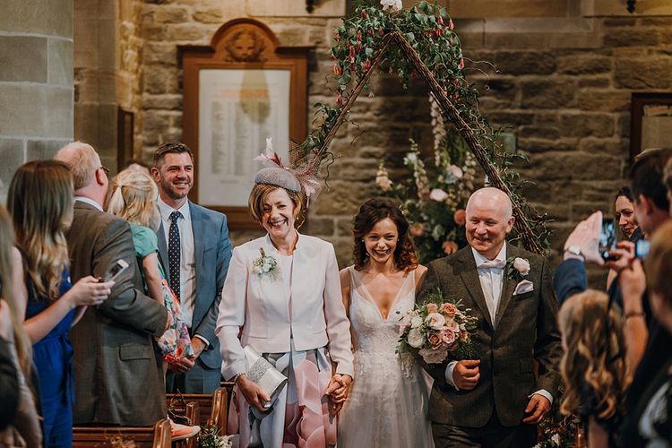 Florals by Mother of the Bride at Abundance Flowers and The Real Flower Company . Tipi Wedding at Home, Cumbria. Pale Dusky Pink, White and Mocha Flowers, Handwritten Details and Festoon Lights. Bride wears Essence of Australia Dress from Angelica Bridal. Groom wears Olive Next Suit and Tan Office Shoes.