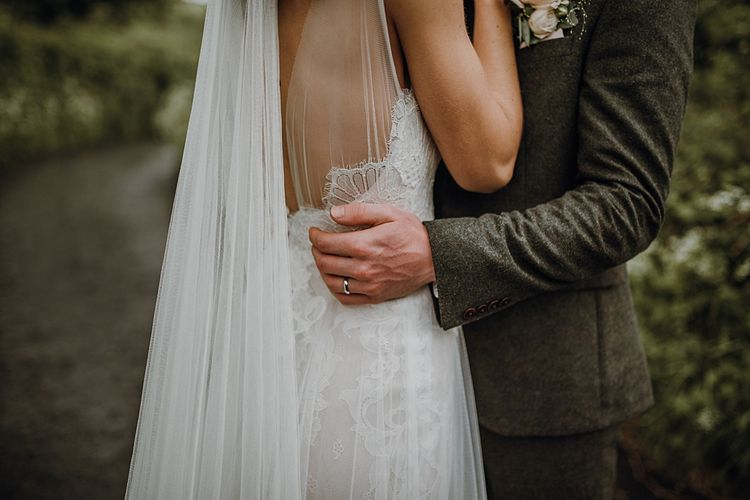 Dress Details. Tipi Wedding at Home, Cumbria. Pale Dusky Pink, White and Mocha Flowers, Handwritten Details and Festoon Lights. Bride wears Essence of Australia Dress from Angelica Bridal. Groom wears Olive Next Suit and Tan Office Shoes.