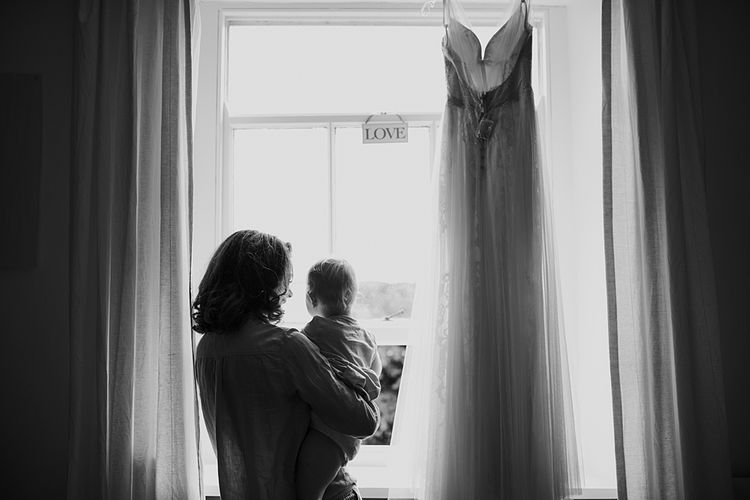 Bridal Morning Preparations.Tipi Wedding at Home, Cumbria. Pale Dusky Pink, White and Mocha Flowers, Handwritten Details and Festoon Lights. Bride wears Essence of Australia Dress from Angelica Bridal. Groom wears Olive Next Suit and Tan Office Shoes.