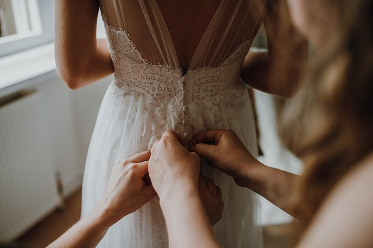 Bridal Morning Preparations. Tipi Wedding at Home, Cumbria. Pale Dusky Pink, White and Mocha Flowers, Handwritten Details and Festoon Lights. Bride wears Essence of Australia Dress from Angelica Bridal. Groom wears Olive Next Suit and Tan Office Shoes.