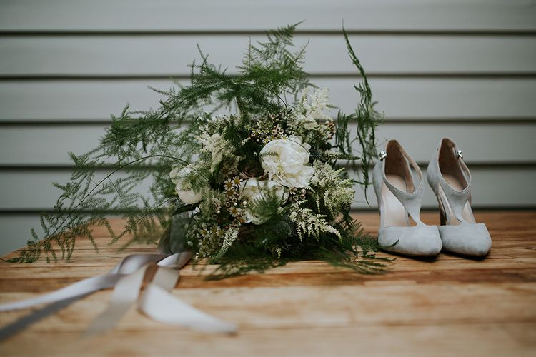 T Bar Suede Wedding Shoes and White and Green Wedding Bouquet