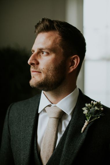 Groom in Charcoal Suit with Wool Tie and Buttonhole