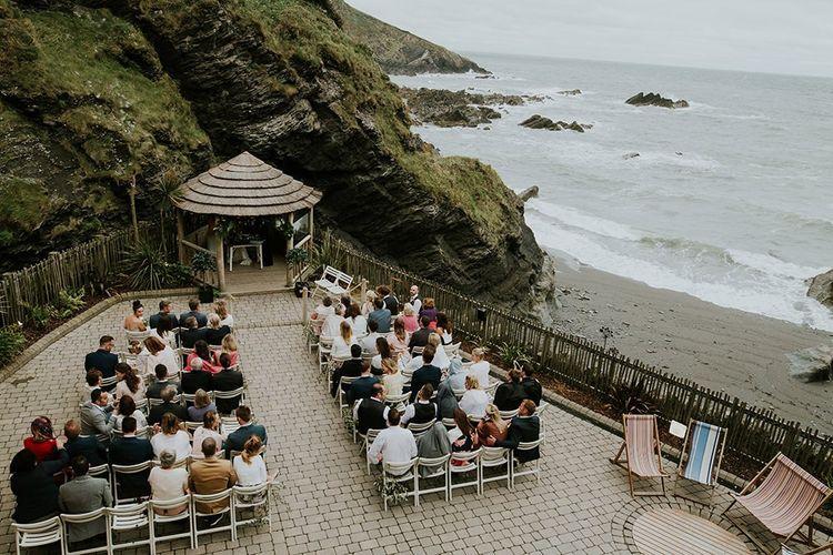 Outdoor Coastal Wedding Ceremony at Tunnels Beaches in Devon