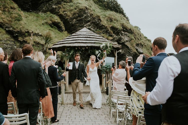 Bride in Lace in Willowby by Watters Wedding Dress and Groom in Chino's and Blazer  Just Married