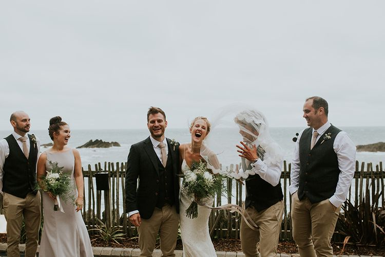 Wedding Party Portrait with Brides Veil Flying in the Wind