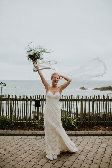 Bride in Lace Willowby by Watters Wedding Dress with Fly Away Veil