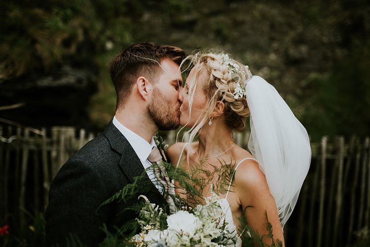Bride with Braided Updo Kissing Her Groom