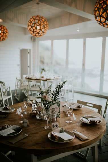 Round Wooden Table with Flower Stem Centrepiece Decor