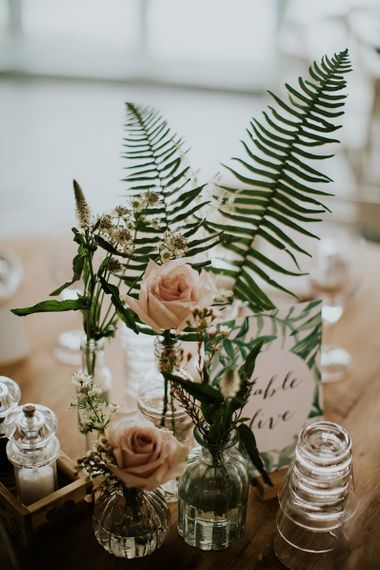 Fern and Rose Flower Stems in Vases and Vessels