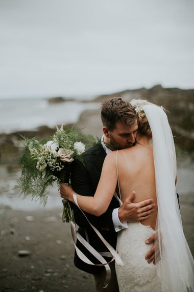 Groom in Blazer Embracing his Bride in a Low Back Willowby by Watters Wedding Dress