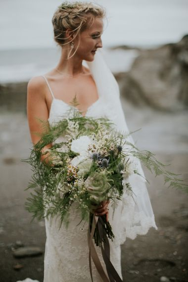 Beautiful Bride with Foliage and Flower Bridal Bouquet