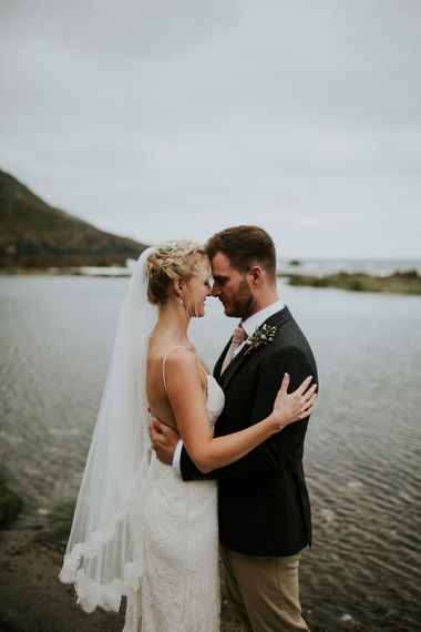 Bride and Groom Embracing by the Beach