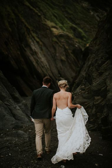 Bride in Backless Wedding Dress by the Cliff's