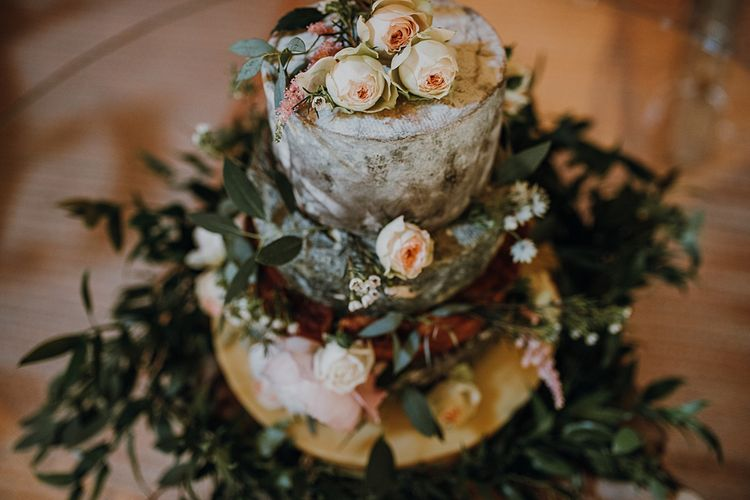 Cheese Cake from the Cheese Larder. Tipi Wedding at Home, Cumbria. Pale Dusky Pink, White and Mocha Flowers, Handwritten Details and Festoon Lights. Bride wears Essence of Australia Dress from Angelica Bridal. Groom wears Olive Next Suit and Tan Office Shoes.