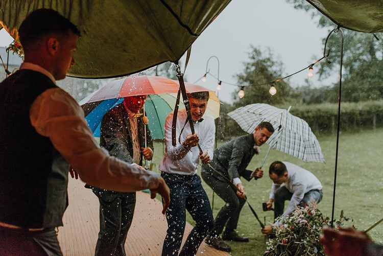 Wet Weather Plan. Tipi Wedding at Home, Cumbria. Pale Dusky Pink, White and Mocha Flowers, Handwritten Details and Festoon Lights. Bride wears Essence of Australia Dress from Angelica Bridal. Groom wears Olive Next Suit and Tan Office Shoes.