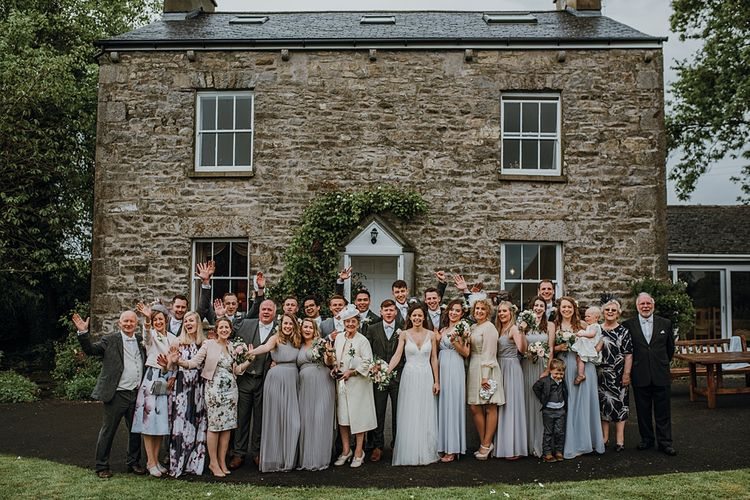 Group Shots. Tipi Wedding at Home, Cumbria. Pale Dusky Pink, White and Mocha Flowers, Handwritten Details and Festoon Lights. Bride wears Essence of Australia Dress from Angelica Bridal. Groom wears Olive Next Suit and Tan Office Shoes.