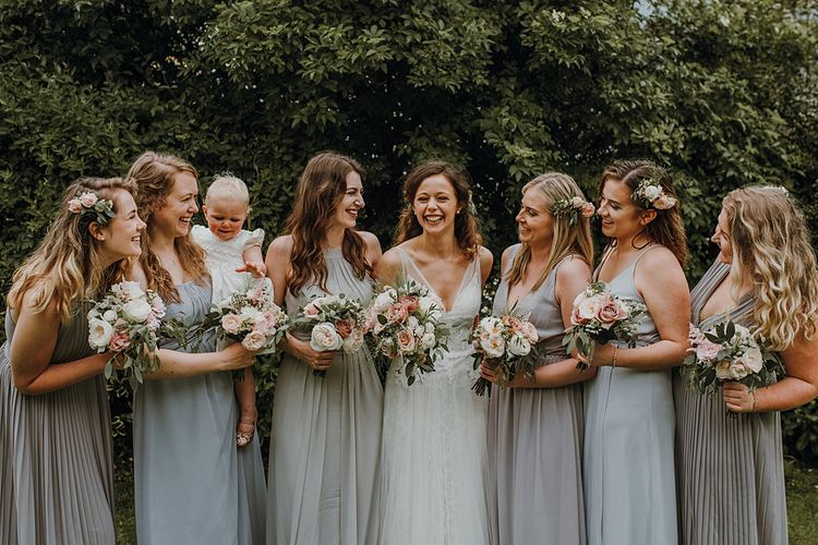 Group Shots. Pale Grey Bridesmaids. Tipi Wedding at Home, Cumbria. Pale Dusky Pink, White and Mocha Flowers, Handwritten Details and Festoon Lights. Bride wears Essence of Australia Dress from Angelica Bridal. Groom wears Olive Next Suit and Tan Office Shoes.