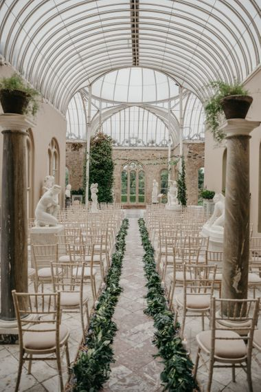 Orangery Ceremony Room  at Killruddery House and Gardens Wedding Venue in Ireland with Greenery Aisle Runway  Decor