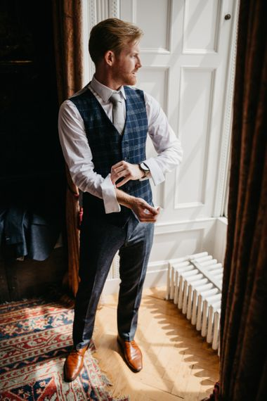 Groom Getting Ready in Bespoke Alton Lane Suit with Check Waistcoat