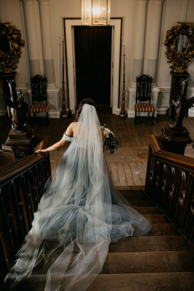 Bride in Tulle Custom Made Blue Claire La Faye Wedding Dress Walking Down The Stairs