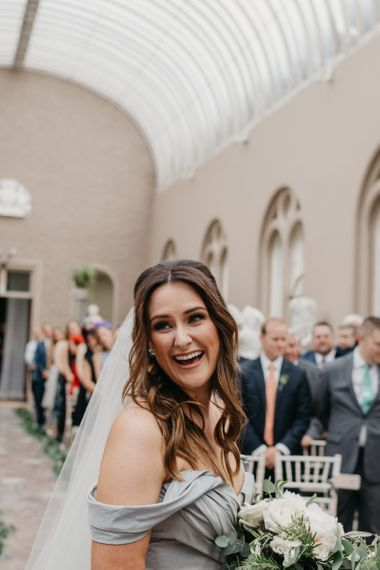 Laughing Bride with Wavy Half Up Half Down Hair