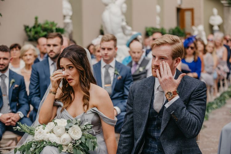 Emotional Bride  in Tulle Custom Made Blue Claire La Faye Wedding Dress and Groom in Bespoke Alton Lane Suit During Orangery Wedding Ceremony
