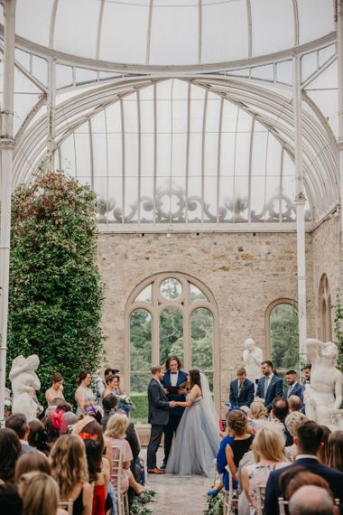 Orangery Wedding Ceremony with Bride  in Tulle Custom Made Blue Claire La Faye Wedding Dress and Groom in Bespoke Alton Lane Suit