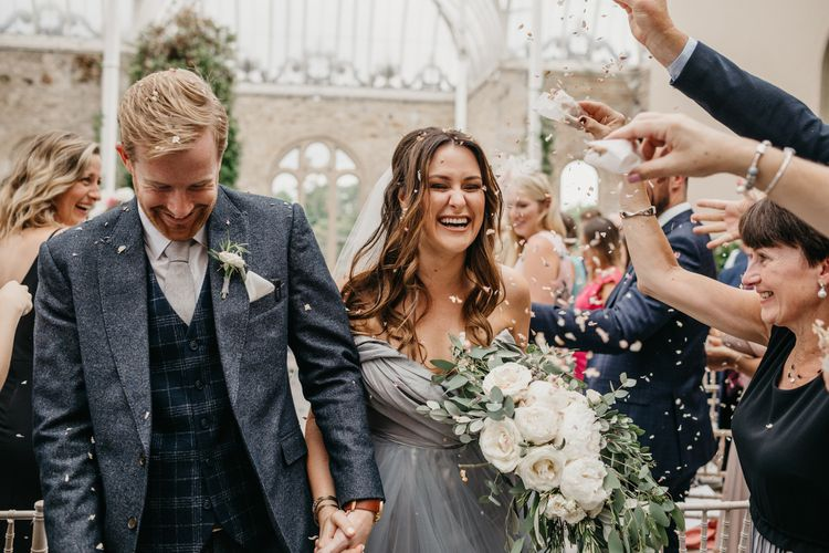 Confetti Wedding Ceremony Exit with Bride  in Tulle Custom Made Blue Claire La Faye Wedding Dress and Groom in Bespoke Alton Lane Suit